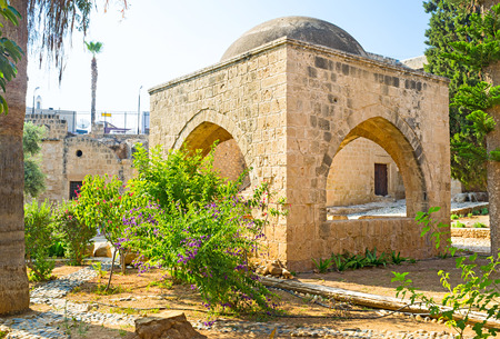best place: The medieval fountain located in the monastery garden and is the best place for relax in shade, Ayia Napa, Cyprus. Stock Photo