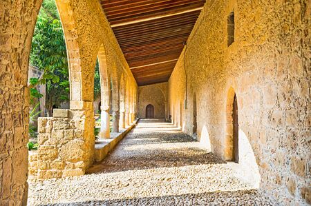 perimeter: The cozy and shady gallery was attached to the monastery rampart around its inner perimeter, Ayia Napa, Cyprus.