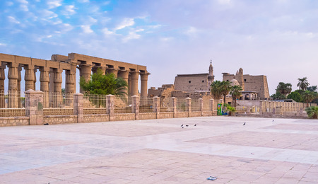 thebes: LUXOR, EGYPT - OCTOBER 8, 2014: The light of the rising sun makes the central square of Luxor unusual and colorful, on October 8 in Luxor.