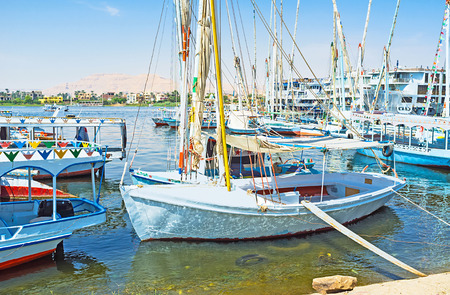 best way: The best way to relax on Nile its to take traditional Egyptian felucca and sail along the banks of Luxor, Egypt. Stock Photo
