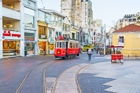 tunel: ISTANBUL, TURKEY - JANUARY 13, 2015: The old tram runs through the  Istiklal Caddesi (Independence Avenue), the central shopping street of the city, on January 13 in Istanbul.