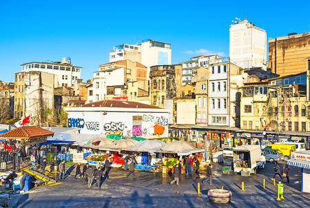 city fish market: ISTANBUL, TURKEY - JANUARY 13, 2015: The fish market next to Galata Bridge is the popular tourist attraction in city, on January 13 in Istanbul. Editorial
