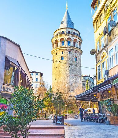 ISTANBUL, TURKEY - JANUARY 13, 2015: The  Galata Tower  is a medieval stone tower in the Galata (Karakoy) quarter, surrounded by numerous outdoor cafes and bars, on January 13 in Istanbul.