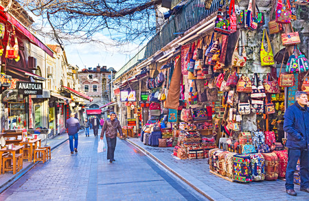kapalicarsi: ISTANBUL, TURKEY - JANUARY 13, 2015: The colorfull stalls located next to the entrance to the Grand Bazaar, on January 13 in Istanbul.