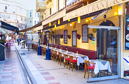 best place: ISTANBUL, TURKEY - JANUARY 13, 2015: The narrow street in the tourist neighborhood is the best place for the cozy cafe or restaurant, on January 13 in Istanbul. Editorial