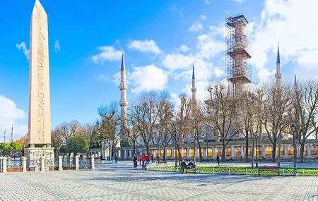 ISTANBUL, TURKEY - JANUARY 13, 2015: The Theodosius obelisk and Blue Mosque, located at Sultanahmet square, on January 13 in Istanbul.