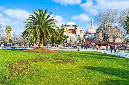 hamam: ISTANBUL, TURKEY - JANUARY 13, 2015: The  Hagia Sophia and Ayasofya Hurrem Sultan Hamam (baths) behind the palms of the Sultanahmet park, on January 13 in Istanbul. Editorial