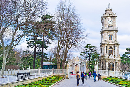treasury: ISTANBUL, TURKEY - JANUARY 13, 2015: The clock tower of Dolmabahce Palace located in front of the Treasury Gate, on January 13 in Istanbul.