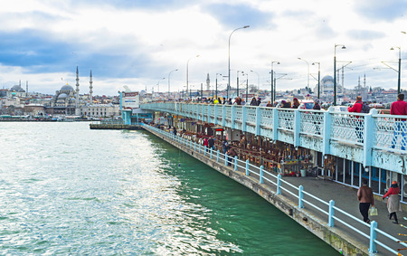 ISTANBUL, TURKEY - JANUARY 13, 2015: The Galata Bridge is the famous tourist destination with cozy cafes, numerous fishermen and best viewpoints, on January 13 in Istanbul.
