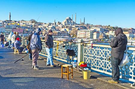 city fish market: ISTANBUL, TURKEY - JANUARY 13, 2015: The turks like fishing on Galata bridge, on January 13 in Istanbul.
