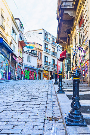 ISTANBUL, TURKEY - JANUARY 13, 2015: The old shopping street with colorful graffiti on the building walls and stores shutters, on January 13 in Istanbul.