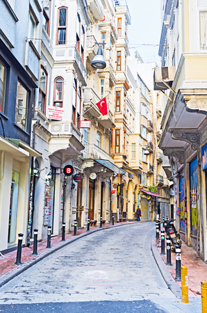 beyoglu: ISTANBUL, TURKEY - JANUARY 13, 2015: The winding street with many stores and cafes in Beyoglu district, on January 13 in Istanbul. Editorial