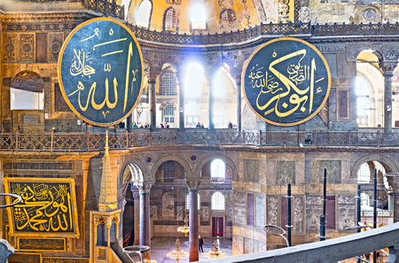ceiling plate: ISTANBUL, TURKEY - JANUARY 13, 2015: The  large calligraphic plates decorates the walls next to the second floor balconies of Hagia Sophia, on January 13 in Istanbul. Editorial
