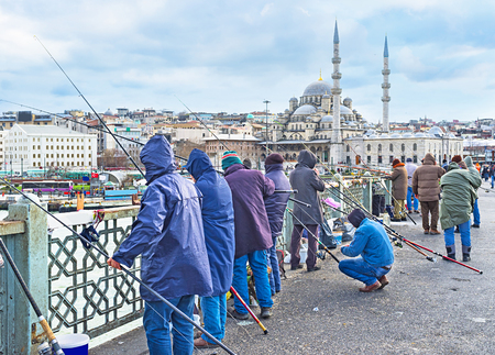 city fish market: Galata Bridge is the favorite and traditional place for fishing, every day numerous local fishermen come here to relax and enjoy their hobby, Istanbul, Turkey.