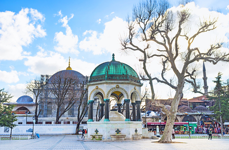 hippodrome: ISTANBUL, TURKEY - JANUARY 13, 2015: The German Fountain on Sultanahmet Square (hippodrome) with the Blue Mosque on the background, on January 13 in Istanbul. Editorial