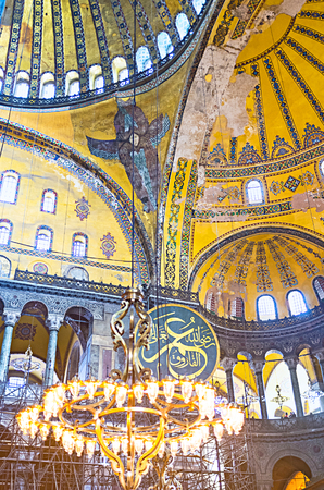 ceiling plate: ISTANBUL, TURKEY - JANUARY 13, 2015: The  beautiful mosaic with ornaments, calligraphic medalions and Hexapterygon (six-winged angel) decorates the domes of Hagia Sophia, on January 13 in Istanbul.