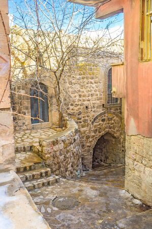 mesopotamian: The narrow street going down to the shopping area of the old town of Mardin, Turkey. Editorial