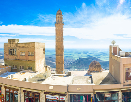 mesopotamian: MARDIN, TURKEY - JANUARY 14, 2015: The high minaret of the Great Mosque located in the old town, on January 14 in Mardin. Editorial