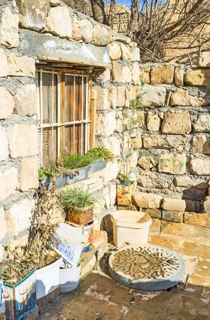 MARDIN, TURKEY - JANUARY 14, 2015: The tiny stone courtyard in the old neighborhood, on January 14 in Mardin.