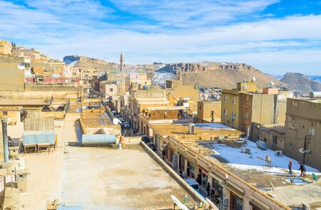 MARDIN, TURKEY - JANUARY 14, 2015: The medieval arabic town boasts narrow winding streets, old houses and mansions and high minarets, on January 14 in Mardin. Editorial