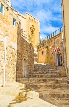 mesopotamian: The narrow staircase leading to the upper town with its old landmarks, Mardin, Turkey. Editorial