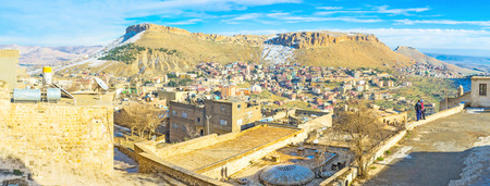 mesopotamian: The cityscape of Mardin with the rocky mountain in the background, Turkey. Editorial