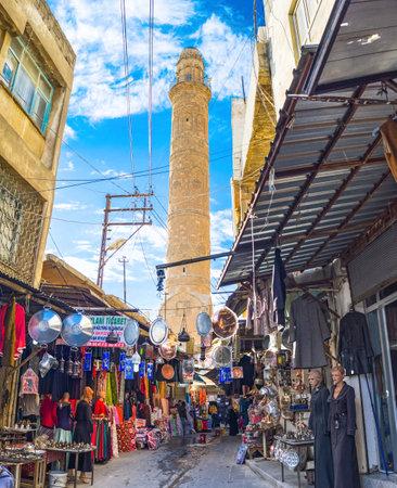 mesopotamian: MARDIN, TURKEY - JANUARY 14, 2015: Traditional arabic market runs through the narrow streets and leads to the Grand Mosque, on January 14 in Mardin.