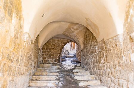 The medieval Mardin is full of the narrow streets and tiny passes under the houses, Turkey.
