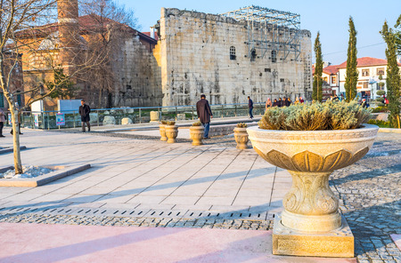 neighboring: ANKARA, TURKEY - JANUARY 16, 2015: The ancient Roman temple is neighboring with the medieval Hacı Bayram Mosque, on January 16 in Ankara.
