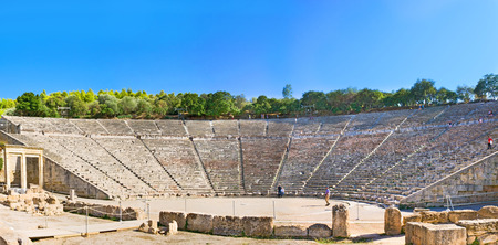 archaeological site: EPIDAVROS, GREECE - OCTOBER 11, 2013: Panorama of the famous for its symmetry and beauty Epidaurus theatre, located in the large archaeological site, on October 11 in Epidavros.