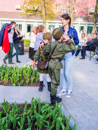 old styled: MOSCOW, RUSSIA - MAY 9, 2015: The chidren in old styled military costumes in the Hermitage Garden, on May 9 in Moscow. Editorial