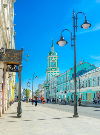 beheading: MOSCOW, RUSSIA - MAY 9, 2015: The Pyatnitskaya street located in the tourist neighborhood in Zamoskvorechye district and famous for numerous cafes, stores and art galleries, on May 9 in Moscow.