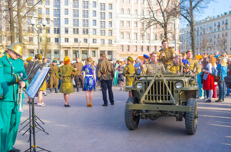 brass  band: MOSCOW, RUSSIA - MAY 9, 2015: The brass band and Red Army soldiers on the costume festival on Strastnoy Boulevard, on May 9 in Moscow. Editorial