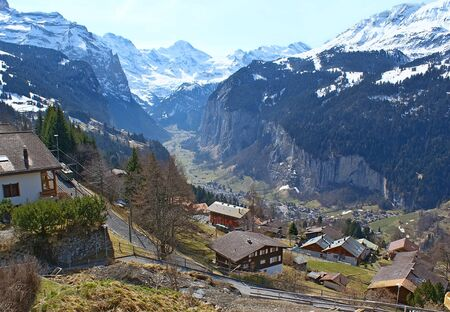 snowbound: The aerial view on the Lauterbrunnen Valley, surrounded by the snowbound mountains, from the Wengen village, Switzerland.