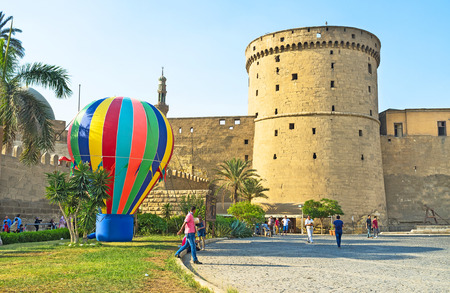 rampart: CAIRO, EGYPT - OCTOBER 9, 2014: The high rampart with the large tower next to the entrance to the Saladin Citadel, on October 9 in Cairo.