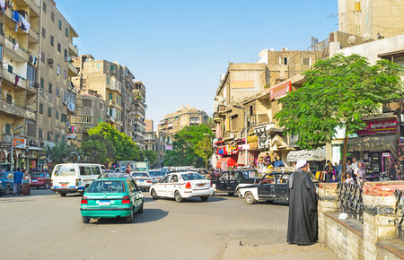 traffic jams: CAIRO, EGYPT - OCTOBER 9, 2014: The old residential streets are full of tiny shops, stalls, teahouses and traffic jams, on October 9 in Cairo. Editorial