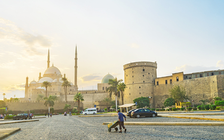 CAIRO, EGYPT - OCTOBER 9, 2014: The  Alabaster mosque in Saladin Citadel looks great in the light of sunset, on October 9 in Cairo.