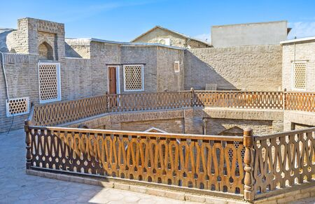second floor: The terrace of the second floor of the restored Caravan Saray, serving as hotel, Bukhara, Uzbekistan. Editorial