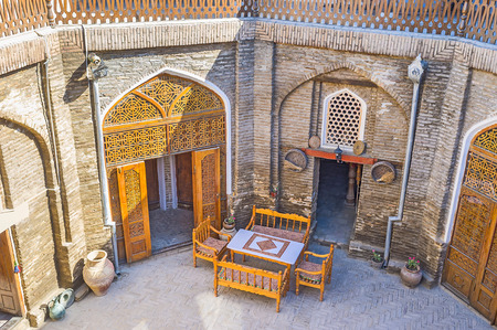 best place: The tiny cafe in the shady courtyard of the restored Caravan Saray is the best place to relax, Bukhara, Uzbekistan. Editorial