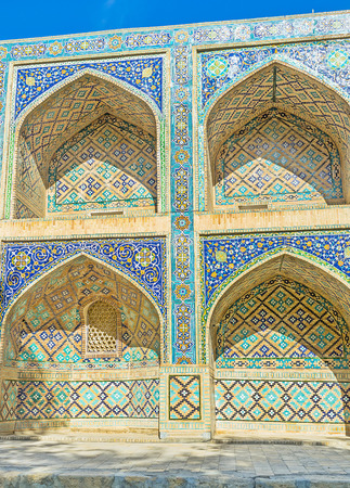 majolica: The arches of Nadir Divan-Beghi madrasah is decorated with multicolored majolica with floral and geometric traceries, Bukhara, Uzbekistan.