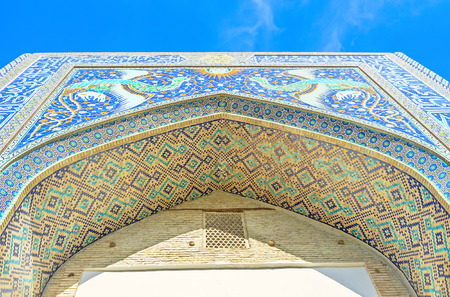 bird house: The central portal of Nadir Divan-Beghi madrasah is decorated with majolica depicting the phoenixes, flying to the sun, Bukhara, Uzbekistan.
