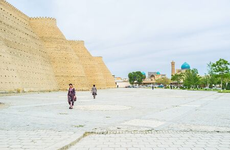 ark: The Ark fortress with the Po-i Kalyan complex on the background in Bukhara.