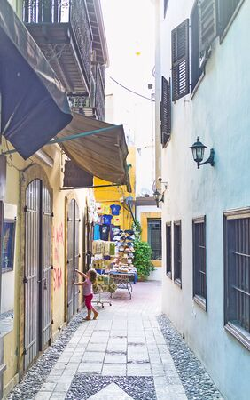 backstreet: NICOSIA, CYPRUS - AUGUST 4, 2014: The narrow backstreet in the old city neighborhood, on August 4 in Nicosia.