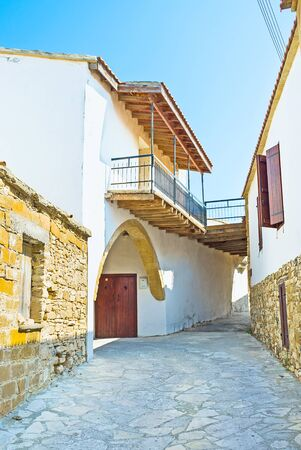 maroni: The scenic white house with the pass-through, going outside the village, Maroni, Cyprus. Stock Photo