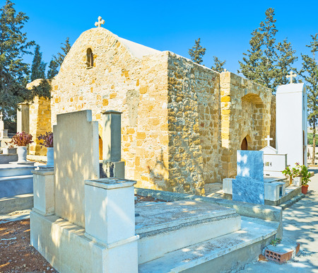 maroni: The small cemetery and the medieval stone church on the background, Maroni, Cyprus.