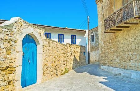 maroni: The bright blue door decorates the medieval stone fence, Maroni, Cyprus.