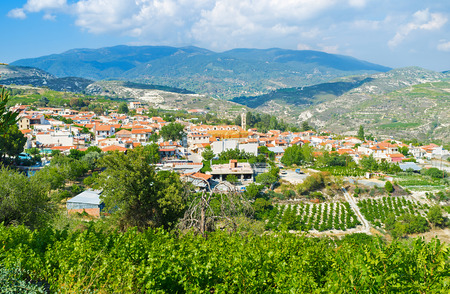 The picturesque village of Omodos located in the mountain valley and surrounded by agriculture lands and fruit gardens, Cyprus.