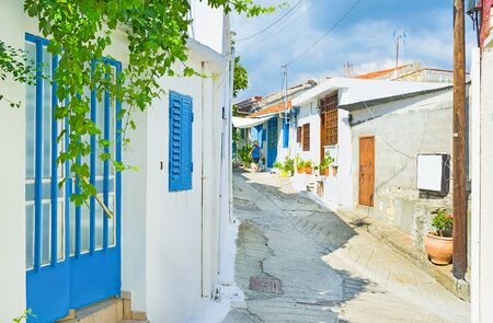 The mountain village consists mostly of the white houses with colorful doors and shutters, Omodos, Cyprus.