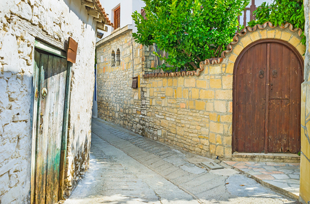 house walls: The small village street with the stone house walls is full of the medieval spirit, Omodos, Cyprus.