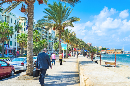 alexandria egypt: ALEXANDRIA, EGYPT - OCTOBER 11, 2014: The comfortable promenade with the shady palms, numerous cafes and shops in the city centre, on October 11 in Alexandria.